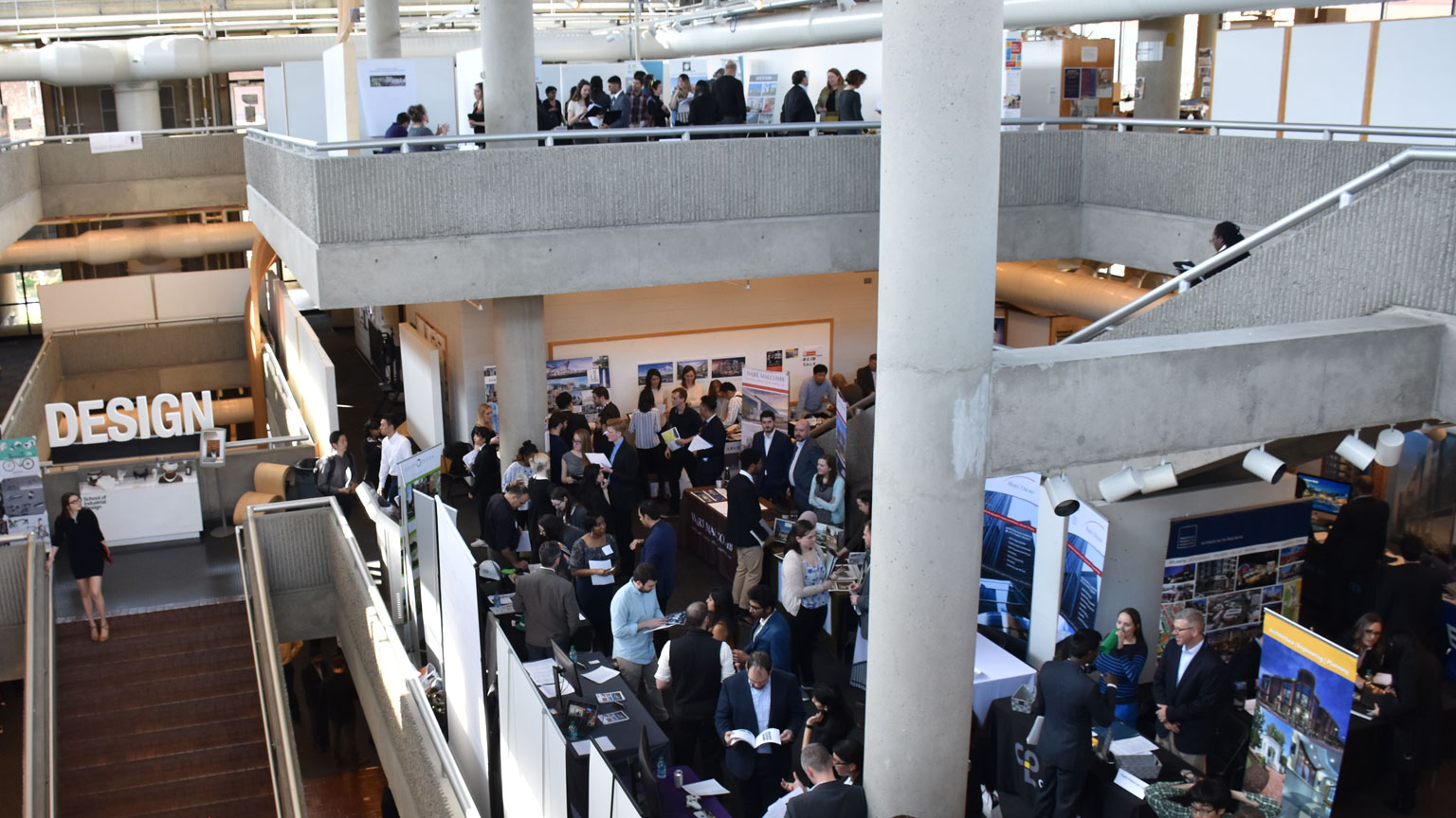 Career Fair 2018 occurring on all three levels of the Architecture West building.