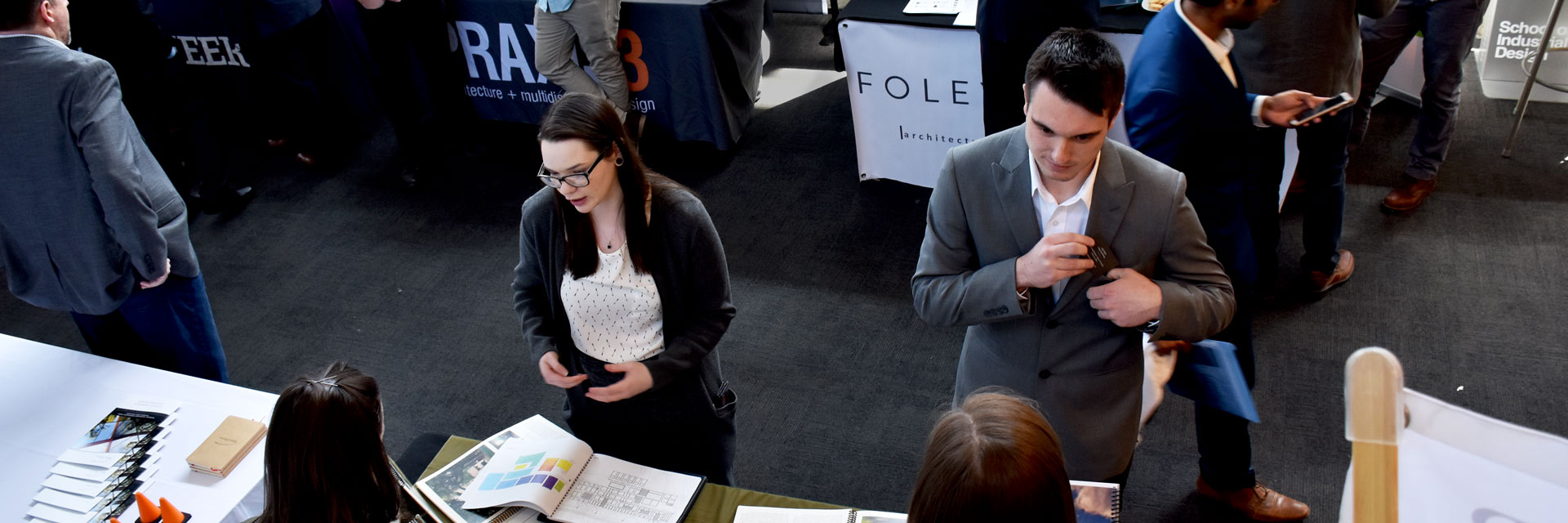 Students at Career Fair 2018 speaking to a recruiter.