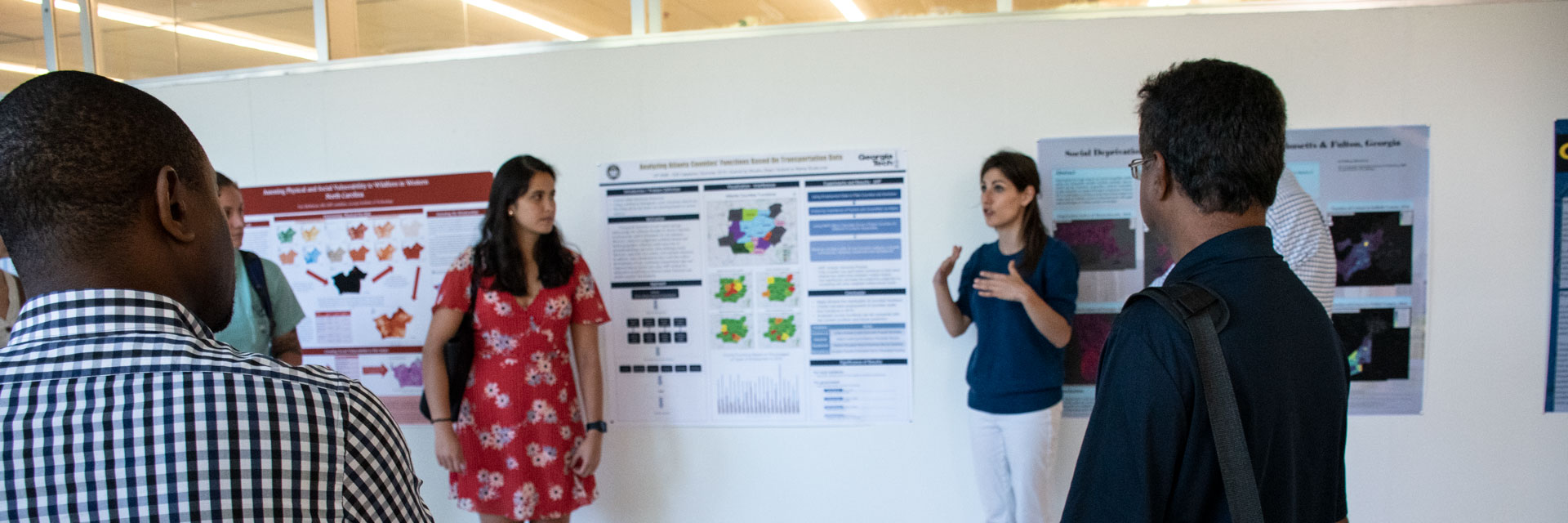 Faculty and students presenting MS-GIST Capstone Projects