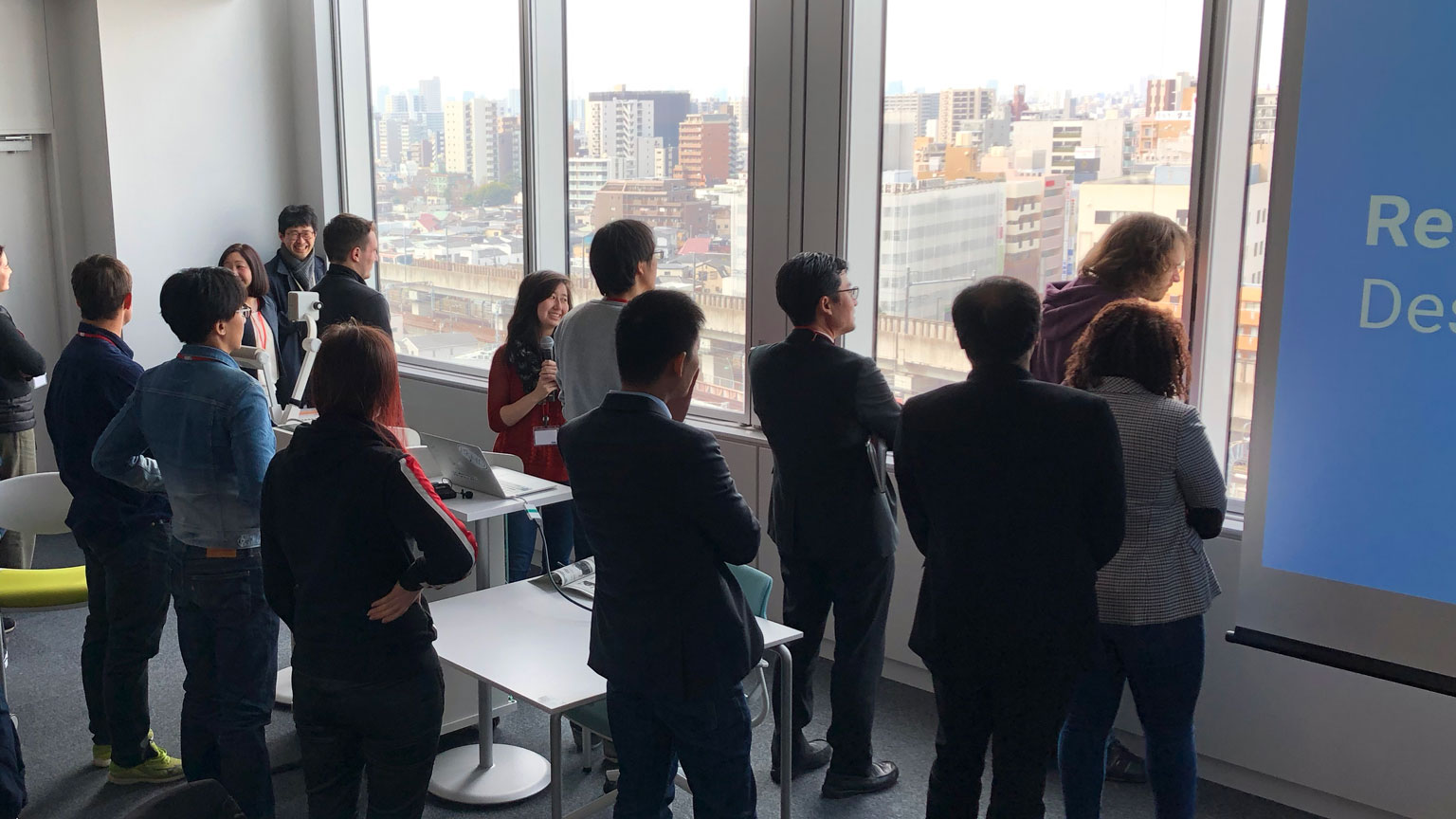 Students preparing for a presentation in a high rise in Tokyo.